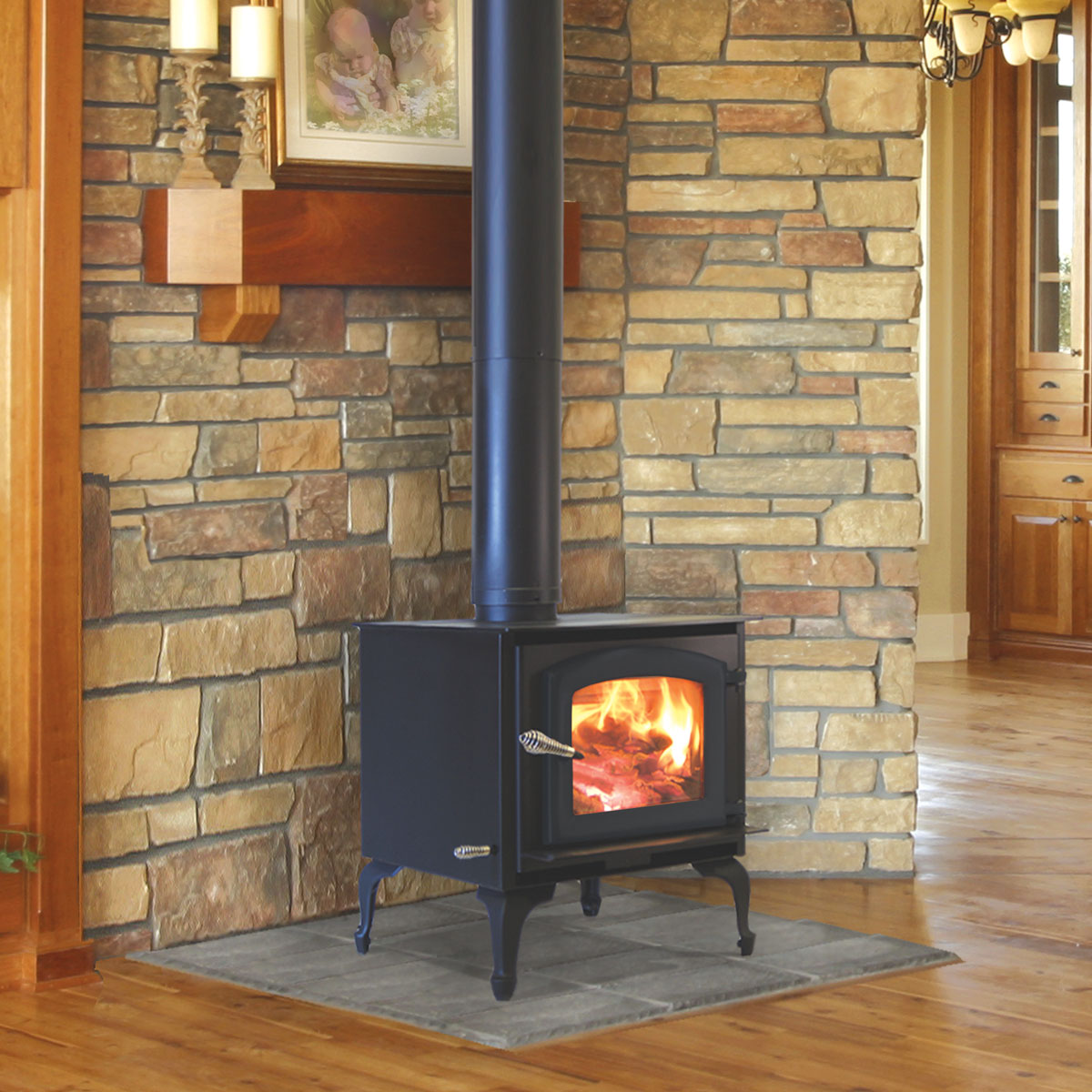 Kuma Aspen wood stove with cast legs and black door - Aspen Wood Stove And Freestanding Fireplace By Kuma Stoves