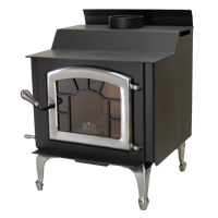 Kuma Tamarack wood stove with pewter legs, sunburst, and pewter door