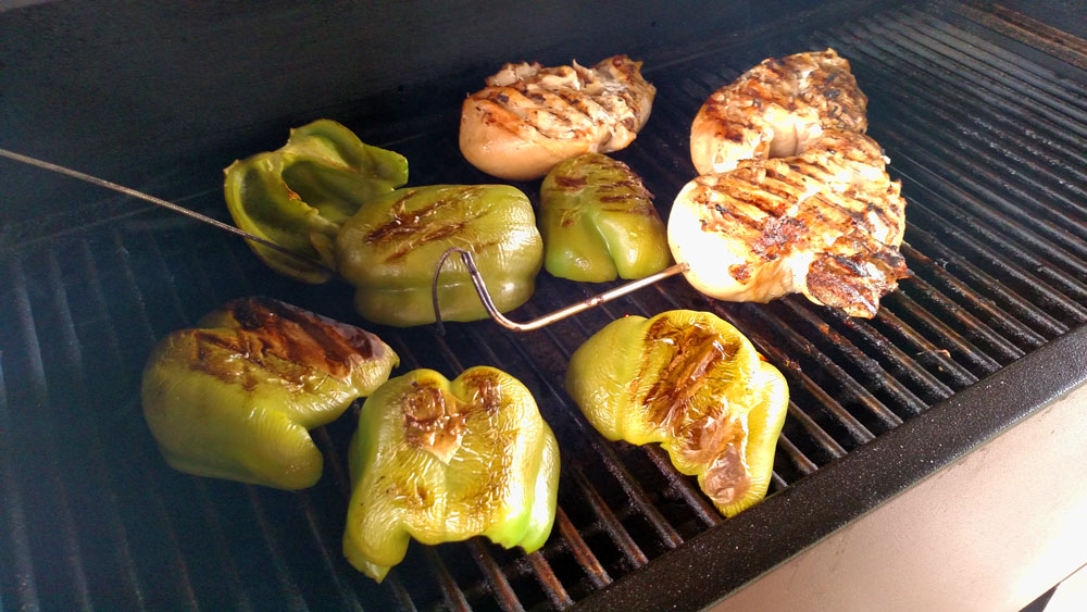 grilled chicken and peppers on a Kuma grill